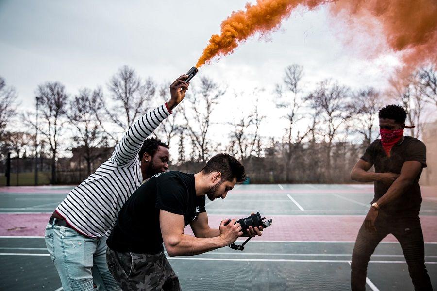 Spraying red smoke during filming